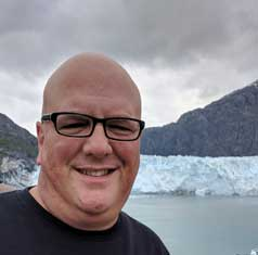 Michael Daniels head shot with glacier in background.