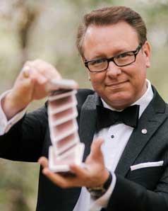 Scott Tokar performing a card trick.